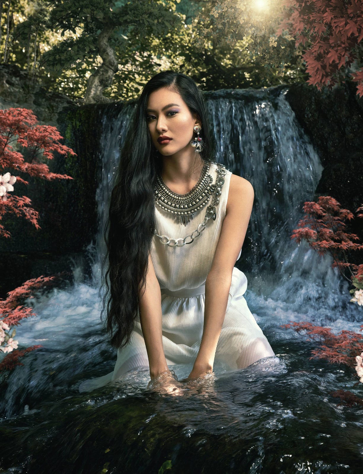 fashion photography of a cinese model posing in a forest with waterfalls
