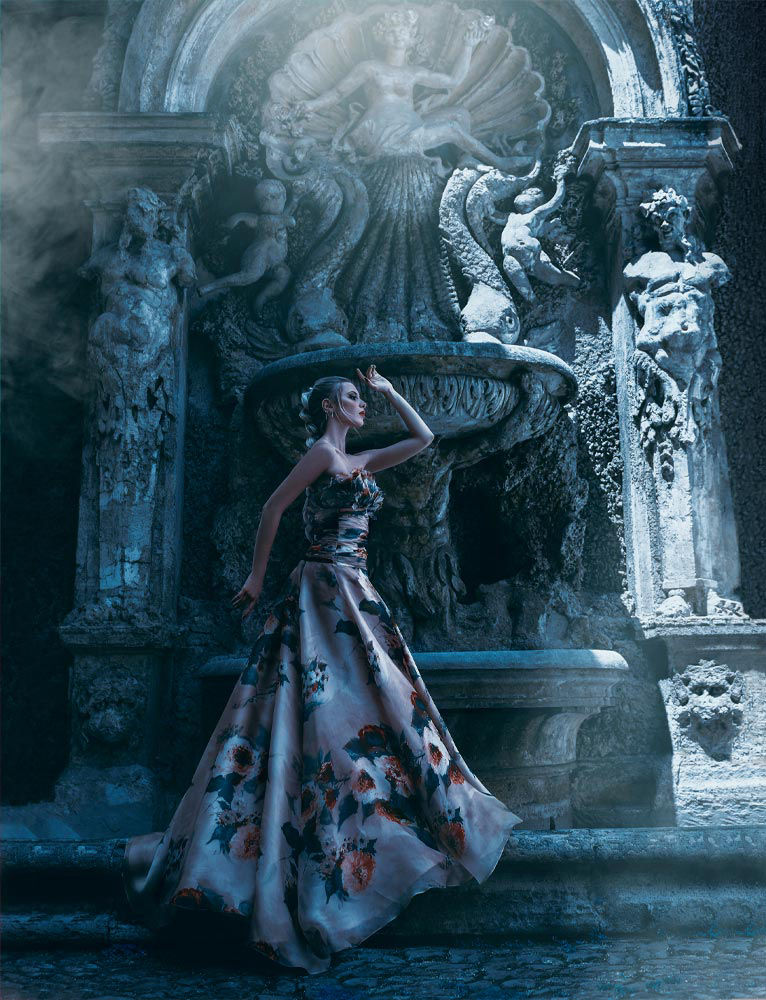 fine art photography of a model posing in ancient rome wearing a long dress